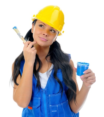 female construction worker: Beautiful young woman doing repairs