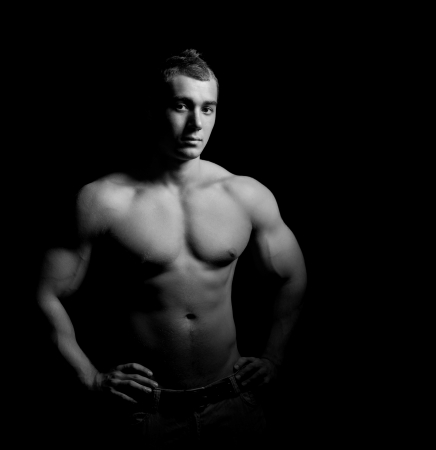 Bodybuilder showing his muscles Stock Photo - 13932701
