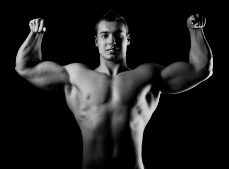Bodybuilder showing his muscles Stock Photo - 13932600