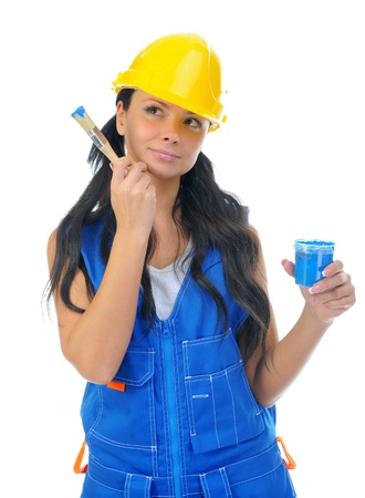 Beautiful young woman doing repairs photo