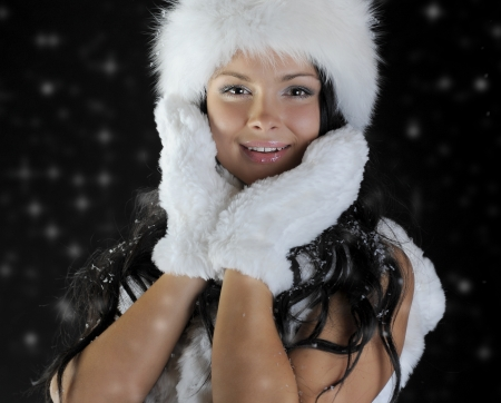 Beautiful woman in a winter hat photo
