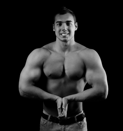 Bodybuilder showing his muscles Stock Photo - 13947090