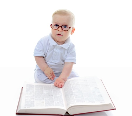 reading glasses: Little boy reads a big book