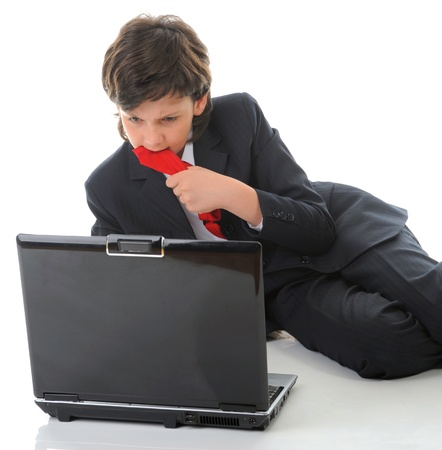 boy in business suit sitting in front of computer Stock Photo - 15077004