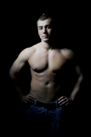 Bodybuilder showing his muscles Stock Photo - 15076999