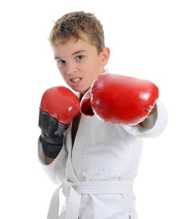 boxing boy: Young boy training karate