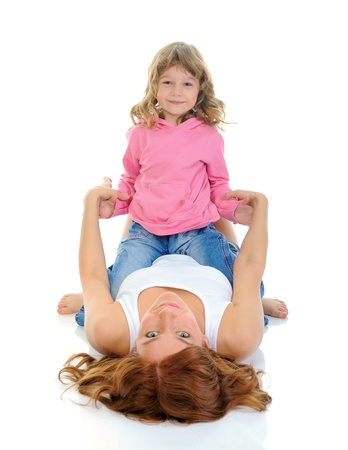 young girl smiling: cheerful girl hugs her young mother