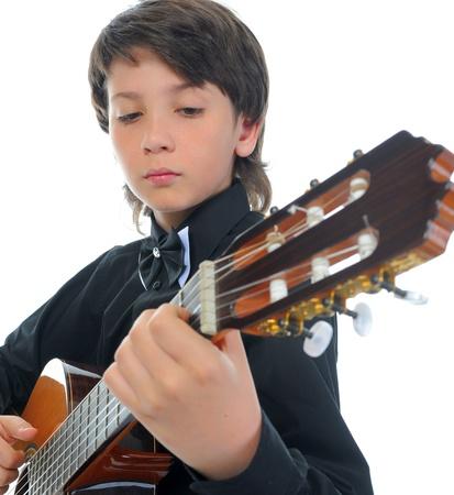 guitar player: Little boy musician playing guitar