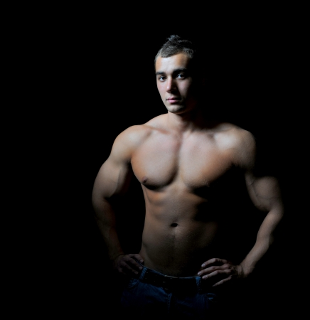 Bodybuilder showing his muscles Stock Photo - 14002752