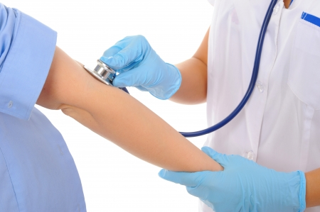 examination stress: Hands With Stethoscope Stock Photo