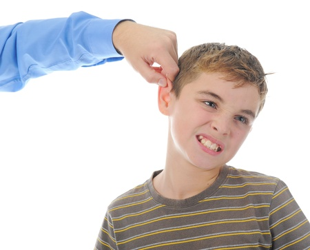 Strict father punishes his son Stockfoto