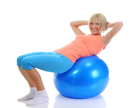 fit ball: Young woman with blue ball Stock Photo