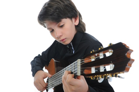 Little boy musician playing guitar photo