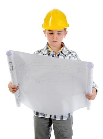 Little smiling builder in helmet Stockfoto