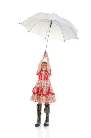 Joyful girl in a pink dress  photo