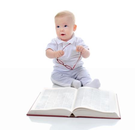 Little boy reads a big book photo
