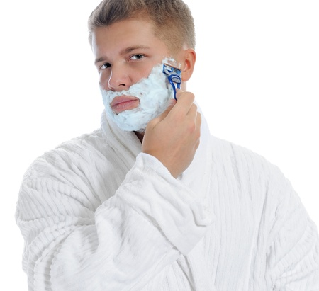 aftershave: Young man shaving