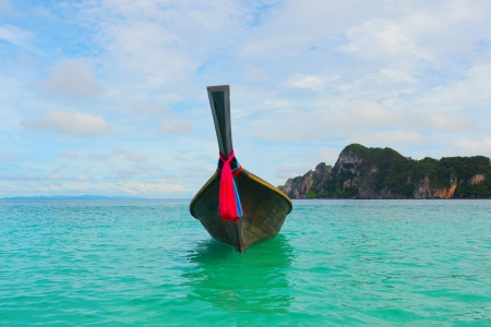 phi phi island: Longtail boat on the sea tropical beach Stock Photo