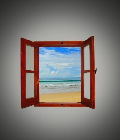looking through an object: Sea view through an open window Stock Photo