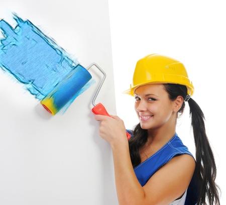 repairs: Beautiful young woman doing repairs