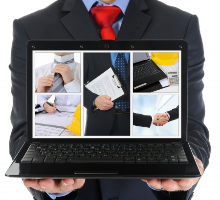 Businessman holding an open laptop photo
