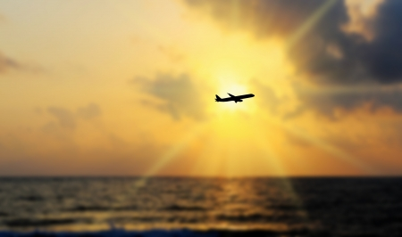 dawning: Airline flying in the sky at night Stock Photo