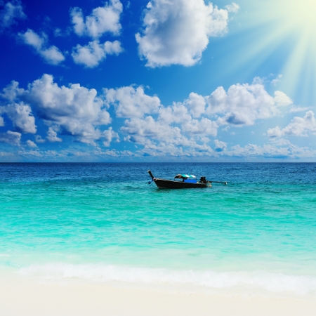 Longtail boat on the sea tropical beach photo