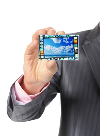 Businessman handing a card photo