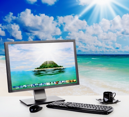 palm computer: Sunny bright office on the beach