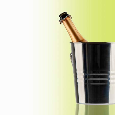 Beautiful picture of a bottle of champagne in an ice bucket photo