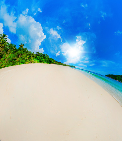 Beautiful sunny beach in the form of the planet photo