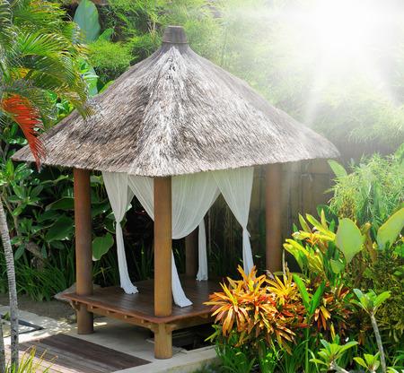 bower: Beautiful bower in a tropical green garden Stock Photo