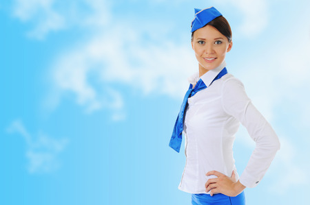 Attractive young stewardess isolated sky blue background Stock Photo - 27735764