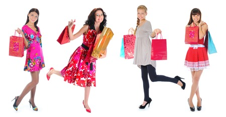 Happy  beautiful young women in a full-length with shopping bags  Isolated on white background photo