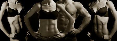 Bodybuilding Forte homme et une femme posant sur un fond noir Banque d'images - 27739055