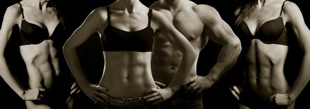 Bodybuilding  Strong man and a woman posing on a black background Standard-Bild