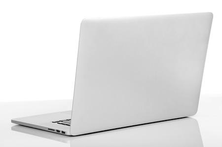 espalda: Nueva computadora portátil con un diseño popular aislado sobre fondo blanco Foto de archivo