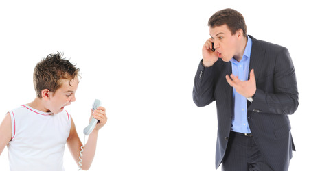 Father and son is arguing while talking over the telephone  Isolated on white background photo