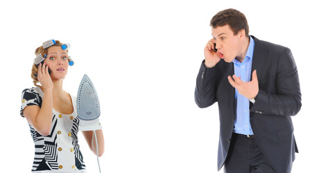 woman shouting: Couple is arguing while talking over the telephone  Isolated on white background Stock Photo