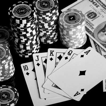 Poker Combination chips Playing cards and dollars in casino