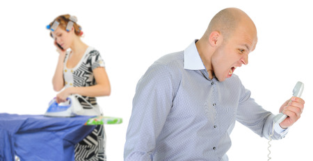 swearing: Couple is arguing while talking over the telephone  Isolated on white background Stock Photo