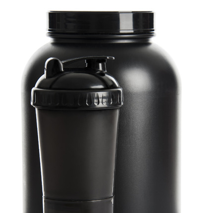 Sport Nutrition, Whey Protein and Gainer  Black Plastic Jars and Shaker isolated on white background photo