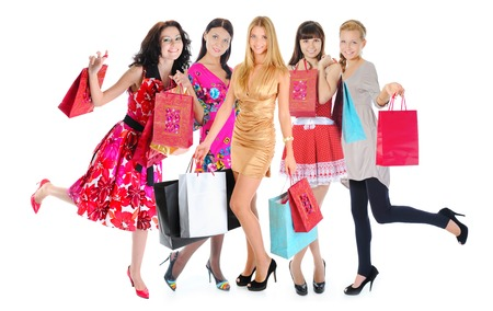 Happy  beautiful young women in a full-length with shopping bags  Isolated on white background Stockfoto