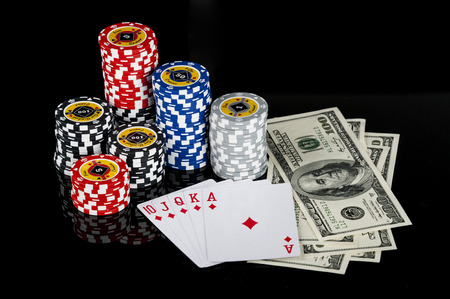 Poker Combination chips Playing cards and dollars in casino photo