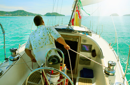 Image of a beautiful yacht in the open sea on a sunny day photo