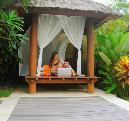Happy smiling couple surfing internet  and enjoy the summer photo