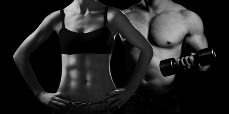 woman posing: Bodybuilding. Strong man and a woman posing on a black background