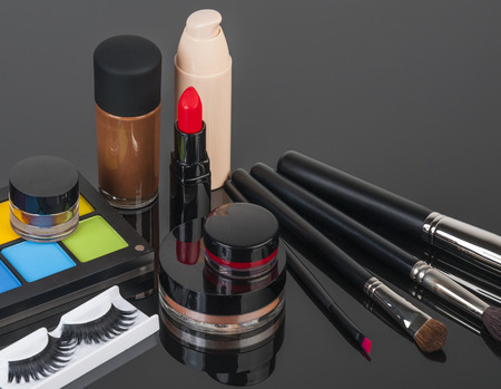 Set of professional makeup and cosmetics. on a black background isolated photo