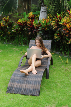 websurfing: Happy smiling woman surfing internet  and enjoy the summer