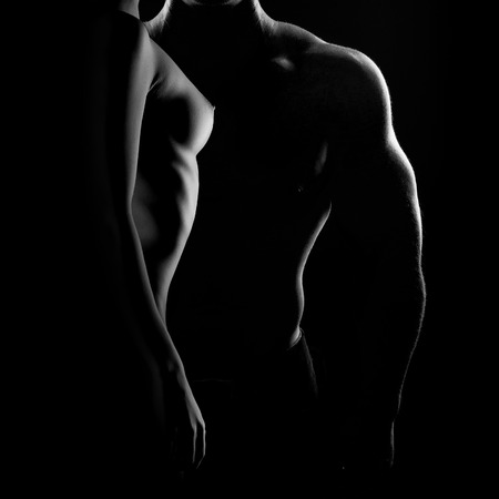 Cuerpo sexy mujer desnuda. Nalgas sensuales desnudos aislados en negro Foto de archivo